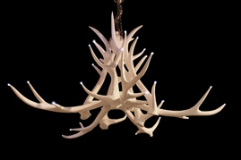 Antler Chandelier 6 arms  Made from cast resin, this unusual chandelier is fitted with LED lights to give it a contemporary look.  Dimensions: 125cm diameter x 65cm high.  Price: £1,660.00 inc VAT excluding carriage.