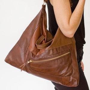 This company will repurpose your leather jacket into a great bag. :)