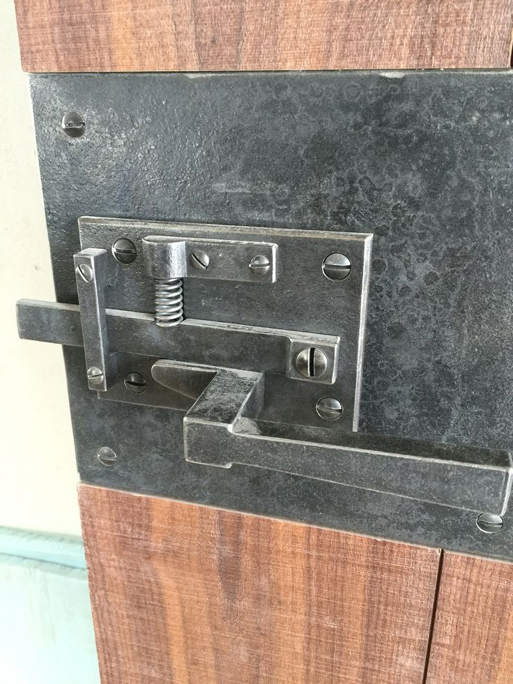Custom forged door hardware designed by JLF and associates and Wild West Iron Works