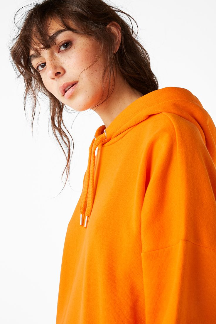 An oversized colour block hoodie sweatshirt that vibes Brooklyn, NY circa '95. The hood's drawstring is threaded through two nifty silver eyelets. Ribbed around the bottom and at the wrists. Cotton-poly blend.