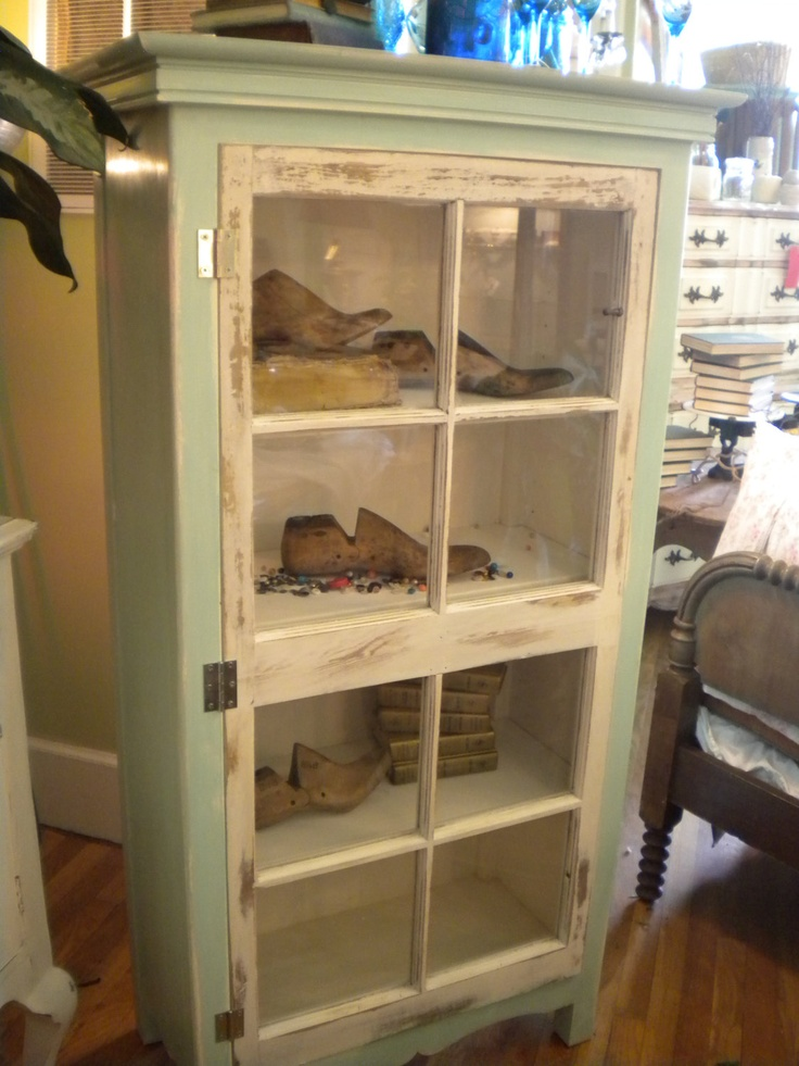 Upcycling at it's finest! Vintage window, hugged by a custom cabinet. Divine.