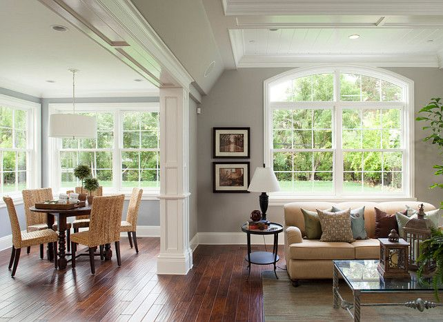 2  Hardwood Floors And White Walls. Wooden And Tan Furnishings. Uses  Greenery