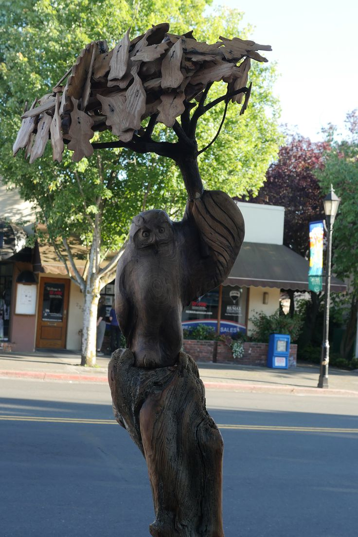 My public art sculpture commission for the Oak Bay district of Victoria, BC. The rainy weather isn't bringing this Great Horned Owl down as he dances along the street. The owl is made from Black Walnut that was harvested close by to my house. The post is Douglas fir driftwood from the west coast of the island. The umbrella pole is an arbutus tree that died of natural causes in our backyard and the oak leaves are made of white oak wood.