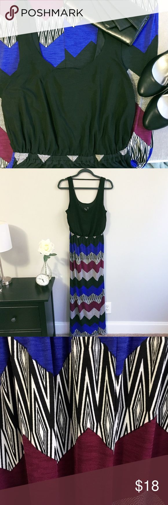 Tribal maxi dress Tribal maxi dress, black top and colorful tribal print bottom. This dress can be dressed up or down, very versatile! Worn once, great condition!! Dresses Maxi