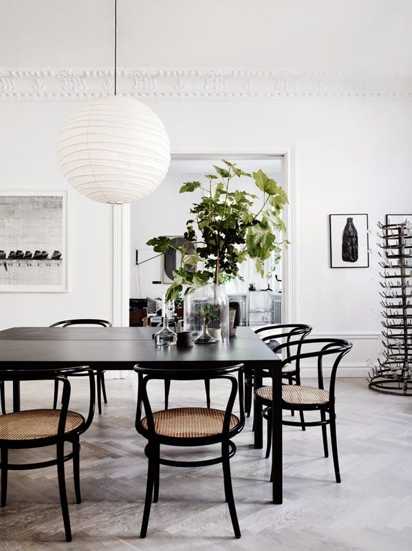 black and white dining room of lotta agaton with vintage thonet chairs
