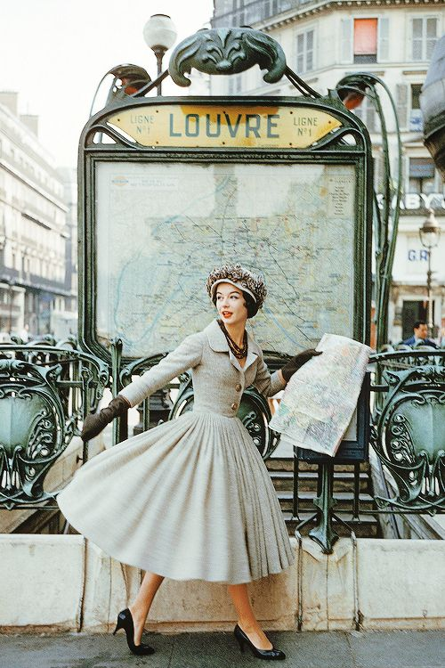 "vintagegal: "" Model wearing a gray Dior suit outside the Louvre Metro station, Paris. Photographed by Mark Shaw, 1957 for LIFE magazine (via) """
