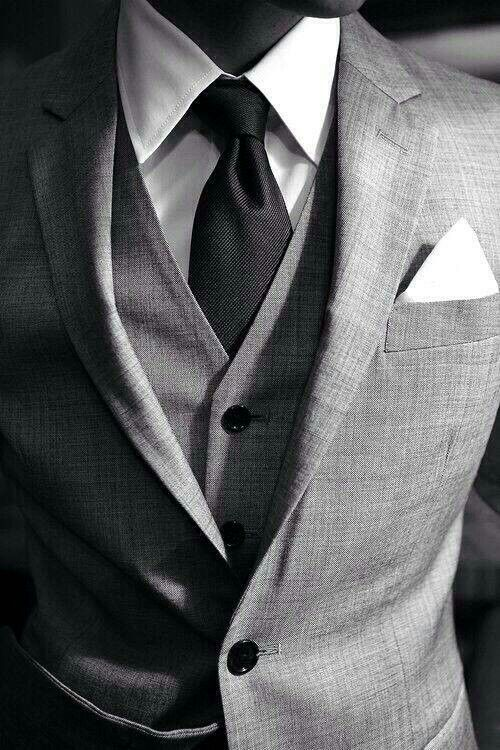 Three piece grey suit white shirt black tie