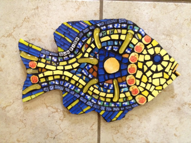 Sun fish mosaic -- I can see this surounding a doorbell button!
