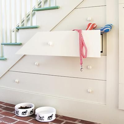 Deep drawers tucked under treads provide storage for pet supplies and other sundries. These can be built just like an old furniture piece, with boxes that glide on wood guides and are faced with angled fronts that fool the eye. | Photo: Alan Shortall/Cornerhouse Stock | thisoldhouse.com