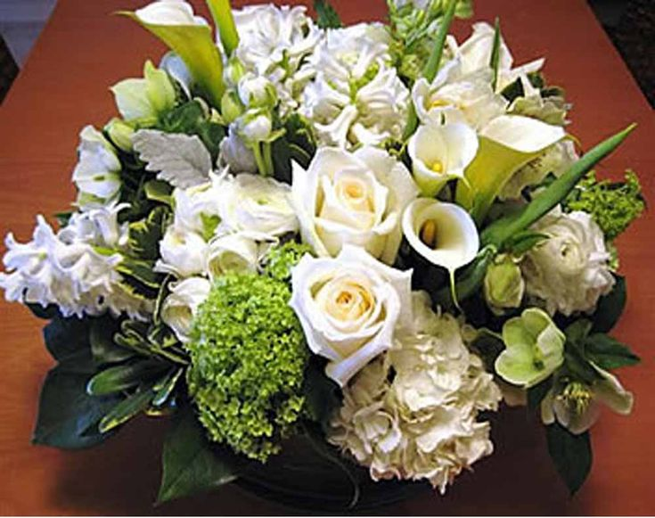 White Calis, Hydrangea, Dusty Miller, Queen Anne's Lace and White roses...How Pretty