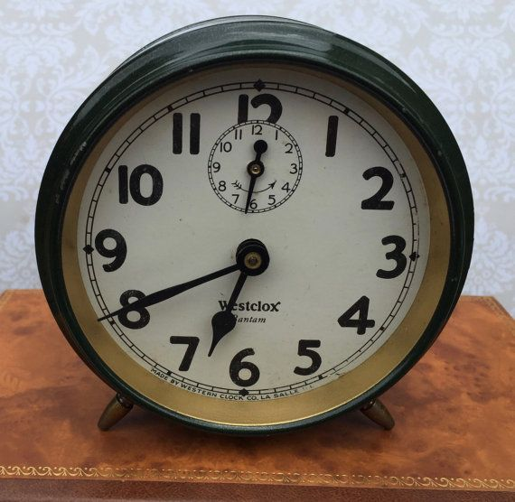 This listing is for a Westclox Bantam Alarm Clock (Style 1).  Westclox was the largest manufacturer of alarm clocks in the world from 1920 to 1980. The Bantam alarm clock was introduced in 1931 as a green painted leg model.  It is still in working order.  https://clockhistory.com/0/westclox/series/series-30-1.html
