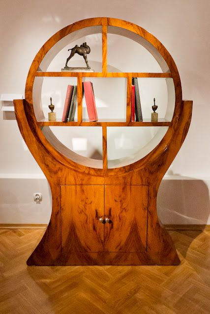 This Shelving Unit Is Very Art Deco Style It S Made Of Wood And Has A