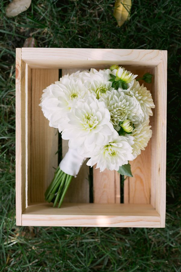 white dahlia bouquet, photo by LaCross Photography http://ruffledblog.com/notwedding-charlotte #weddingbouquet #flowers