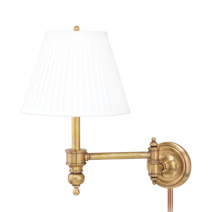 a beautifully detailed traditional swing arm sconce from the chatham collection in an aged brass finish topped with a crisp fabric pleated shade