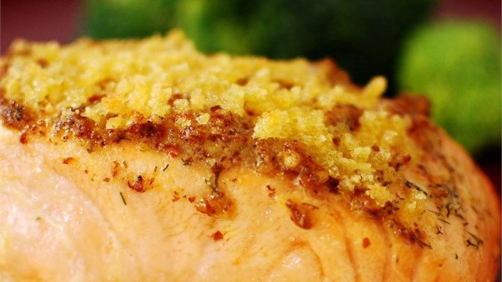 Delicious baked salmon coated with Dijon-style mustard and seasoned bread crumbs, and topped with butter.