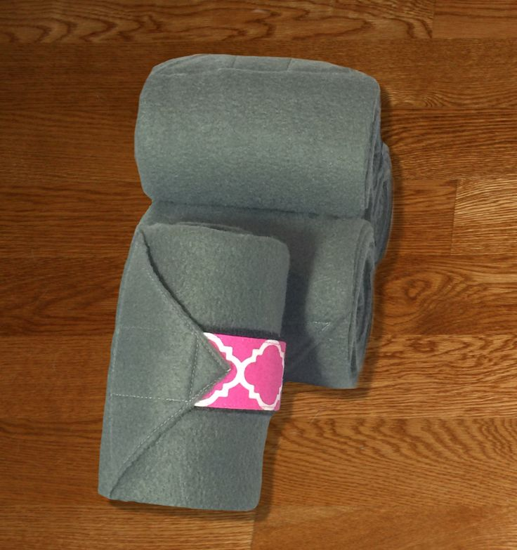 "Equine Polo Wraps/Gray Polo Wraps w/Fuchsia Quatrefoil Velcro Strap by KLMequestrian Deck out your horse in style with these gray polos made with quality gray fleece embellished with fuchsia quatrefoil fabric on the velcro strap. Made with industrial strength velcro to ensure a proper hold. Two sizes offered: Pony: 2 yards (6ft) long, 4"" wide Horse: 3 yards (9ft front, 11ft hind) long, 5"" wide. Four colors offered: Black, Navy, White, or Gray. ​Set of four."