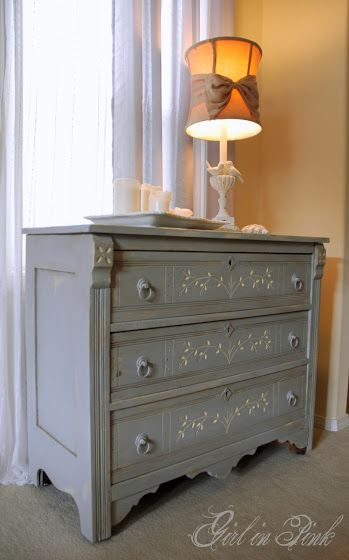 """Eastlake dresser after refinish with Annie Sloan Chalk Paint by Amanda at """"One Girl In Pink"""" blog. Base coat in Cream, Top Coat in Paris Gray. Details touched up in Cream. Finished with clear wax and dark wax."""