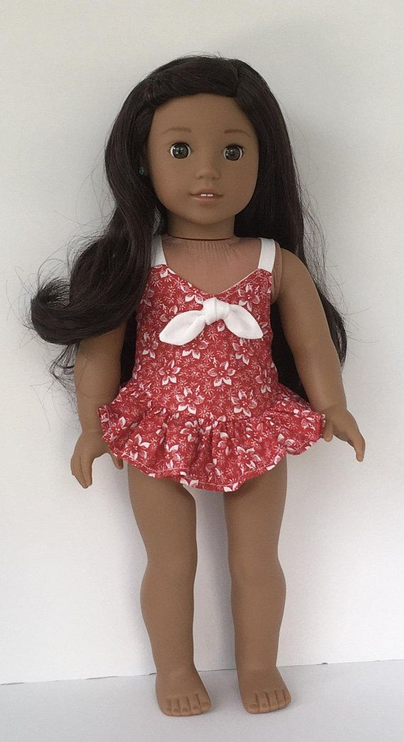 10c19a89417 Get ready for the warm weather with this one piece bathing suit for your  doll. This is made from a red cotton fabric with white tropical flower print .