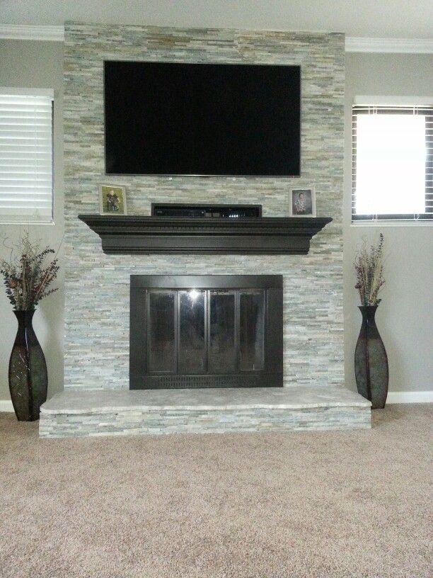 Mini stacked stone fireplace