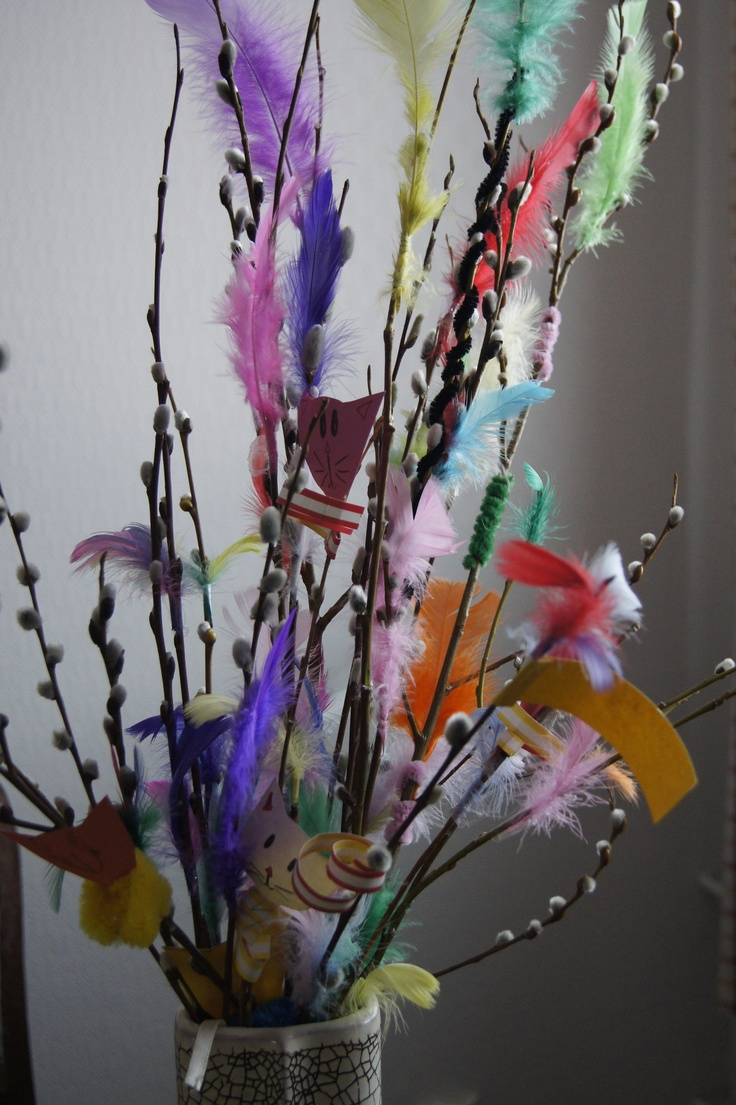 Decorated catkins with colouful feathers