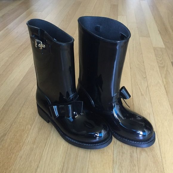 Red Valentino rain boots In excellent condition, worn once black bow Red Valentino rain boots with gold hardware. Great addition to your fall and winter wardrobe. Open to offers, trades and bundling :) RED Valentino Shoes Winter & Rain Boots