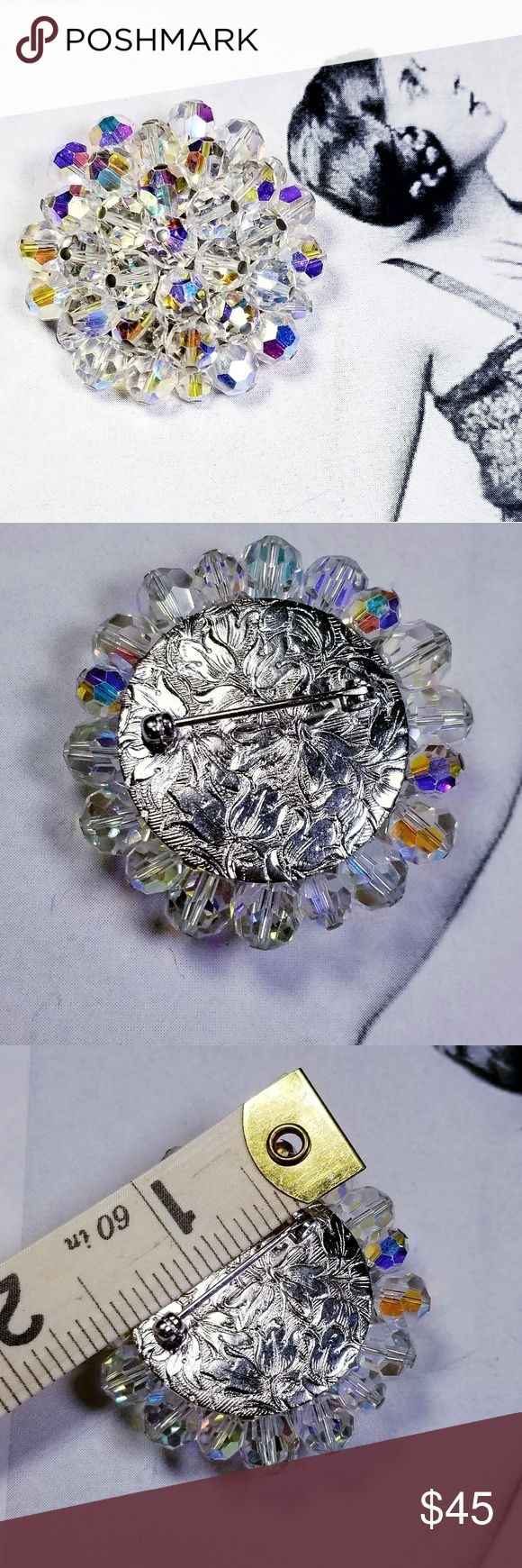 "Vintage rainbow Aurora Borealis crystal brooch Vintage rainbow Aurora Borealis crystal brooch with silver tone floral motif repourposse backing. Pina nd clasp are sturdy and in good working order. Measures 1.75"" x 1.75"" and is in excellent vintage condition reasonable offers welcome and accepted. Add to a bundle and I'll offer you a great deal ❤ looks great with other AB jewelry I have listed Vintage Jewelry Brooches"