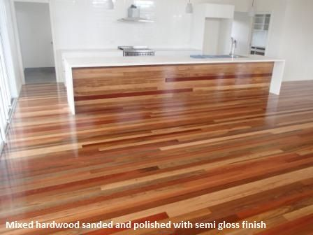 Timber is mixed hardwood. The renovation was completed in Ashgrove. We have sanded and polished the flooring and the wall of the island bench and coated with a semi gloss finish.