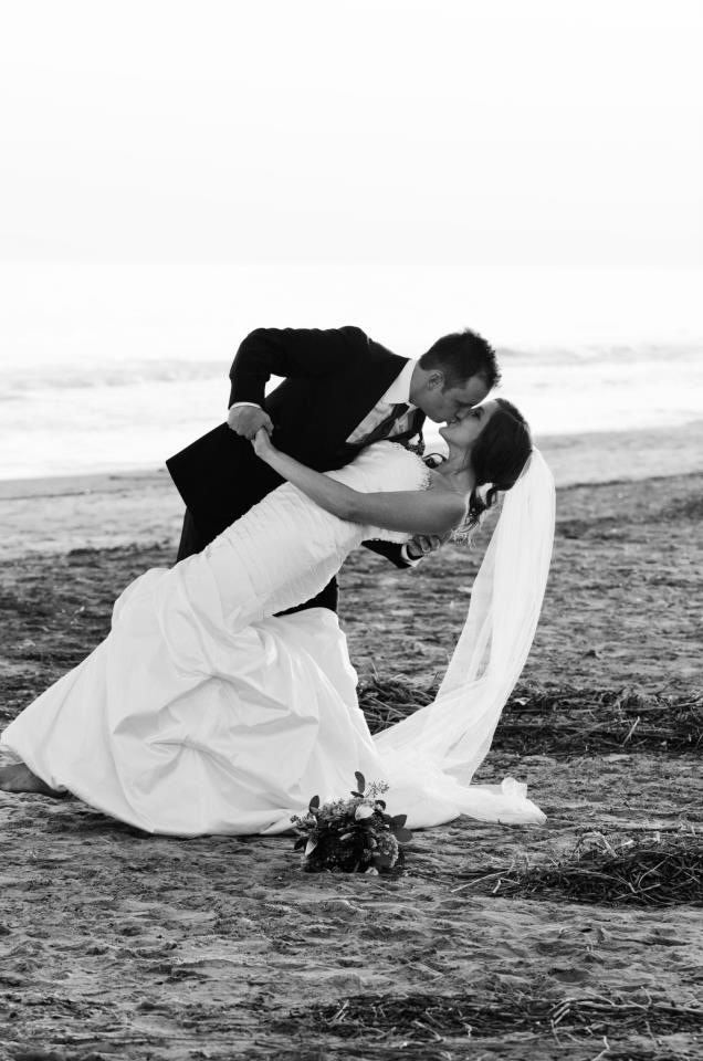 "A ""must have"" beach wedding picture!  So glad our photographer took this shot of us! <3"