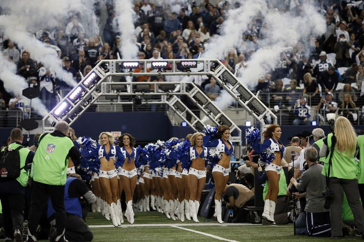 Dallas Cowboys cheerleaders take the field before an NFL wildcard playoff football game against the Detroit Lions, Sunday, Jan. 4, 2015, in Arlington, Texas. (AP Photo/Tony Gutierrez)