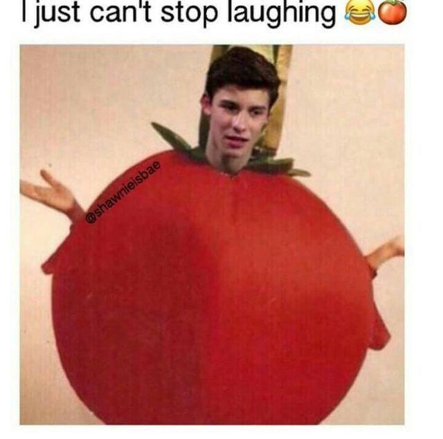He looks like -wtf?why am i wearing  a tomato
