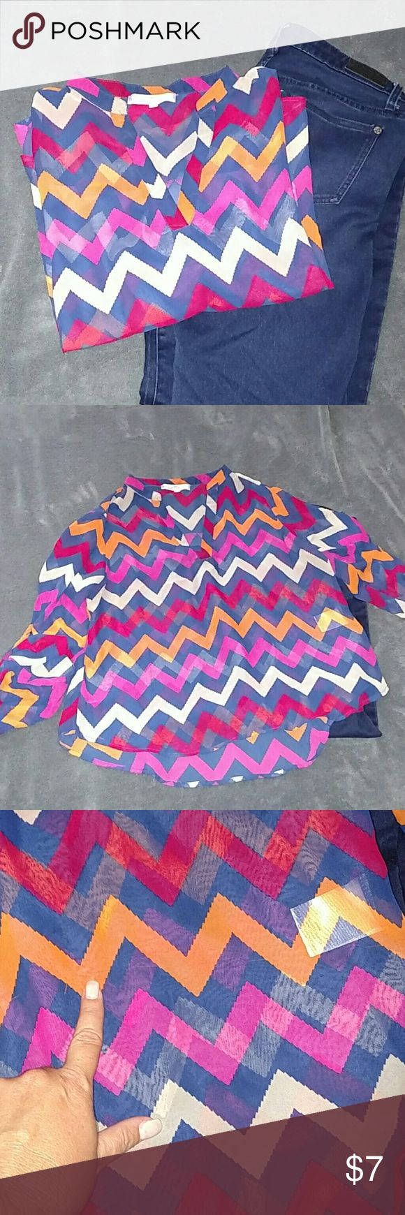 Pretty Chevron Blouse Chevron blouse with beautiful colors: navy blue, fucshia, red, orange, and tan. There's a flaw, it's got 1 pulled thread. Almost Famous Tops Blouses