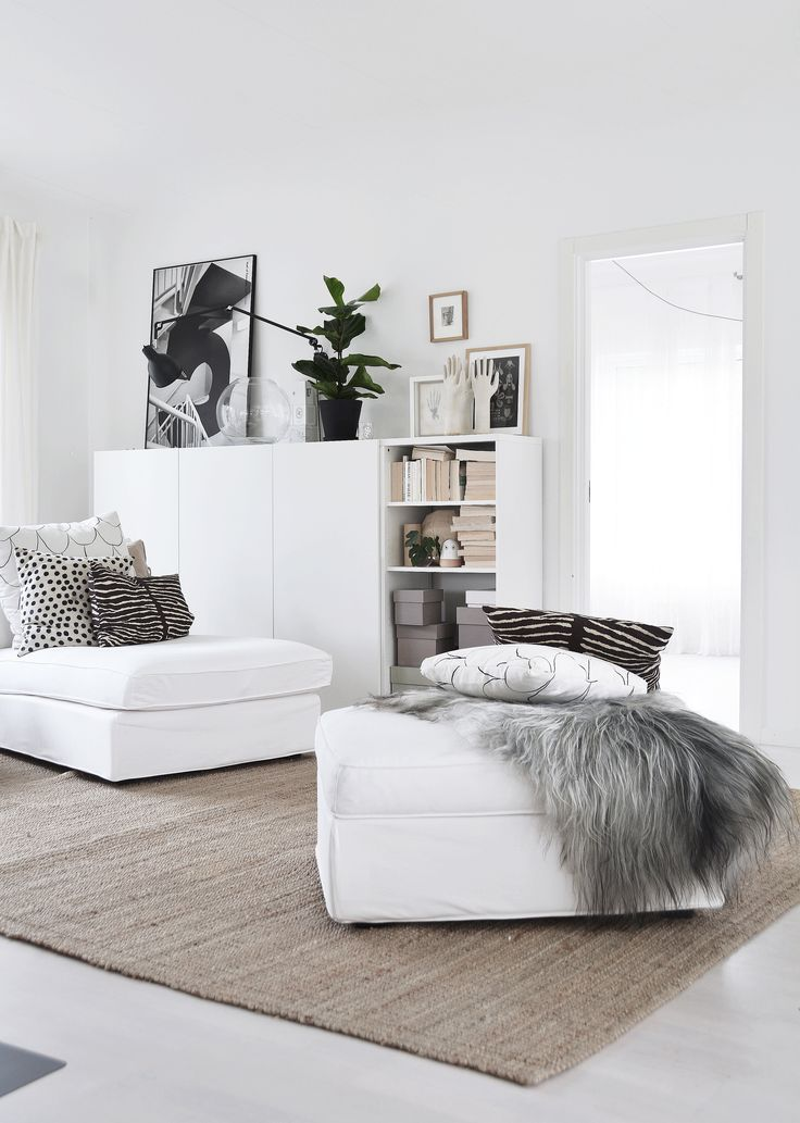 neutral rug + white sofa + white cabinetry