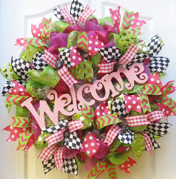 Imagine how cheerful and fun your front door will look with this whimsy welcome wreath! This deco mesh spring and summer mesh wreath is