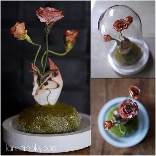 """Spring Finch by Lana Crooks 8"""" x 5"""" x 5"""" Hundreds of tiny silk petals, cut, felted and dyed wool and finely shaved glass under a glass dome #AdventureAwaitsExhibit  #lanacrooks #fiberart #skeleton #bones #curio #wool #skull #finch"""