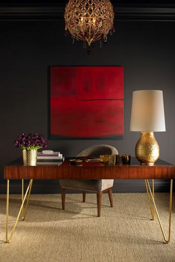 Love the artwork on the dark wall. This desk in a gold tone from AERIN Furniture and Lighting