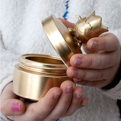 TREASURE BOX made by upcycling a plastic jar (common for body lotion, face cream, etc).  Wash and dry the jar thoroughly.  Glue a plastic toy or knob to the top, then spray paint them gold, silver, whatever color you like (make sure the spray paint is for plastic).