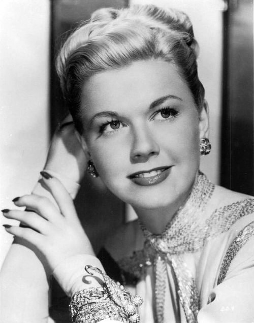 Doris Day... And Doris Day was my moms favorite. DD is why I love my freckles :)
