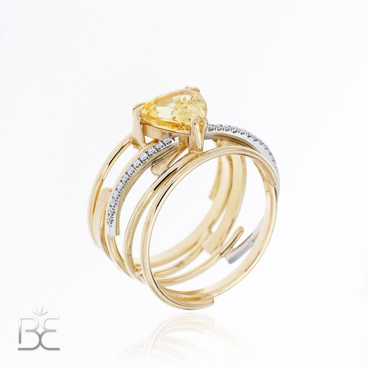 Yellow and white gold, ring with yellow sapphire and diamonds. Contemporary dutch design. Handmade by Sabine Eekels