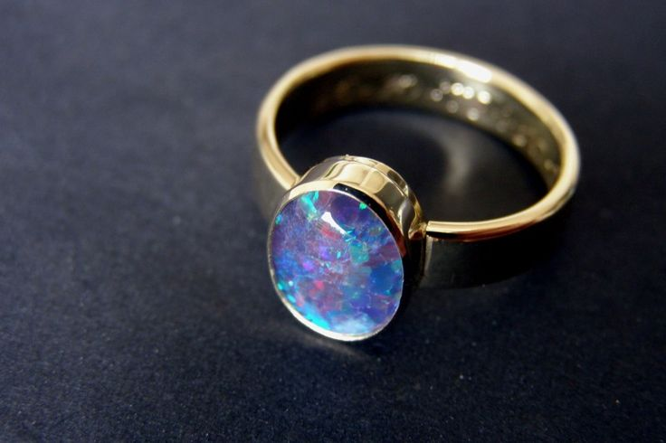 Geel gouden kool design ring met opaal