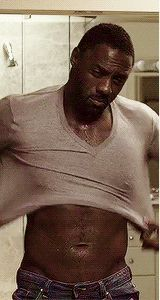 Pin for Later: 19 Painfully Hot Reasons You've Fallen in Love With Idris Elba The Way He Puts On a Sweater Is Renowned by Abdominal Muscle Scholars Across the Globe