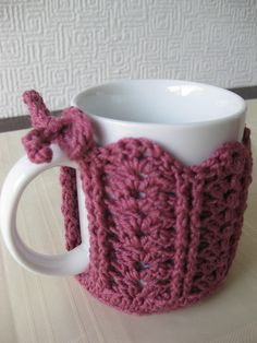 """Coffee Mug Cozy Crochet Pattern (2 British pounds on Ravelry); made this with white yarn, switching to red for round 8 (border and tie); added holly leaves (Attic 24 tutorial on this board) and red buttons for berries."""