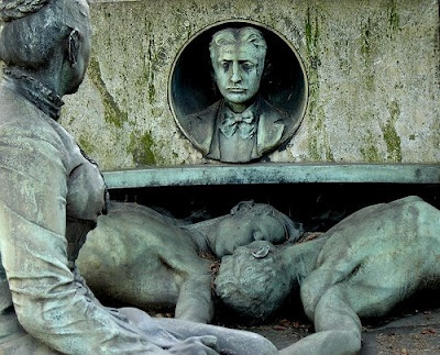 This gravestone is located in Milan, Italy. It seems to tell a story and to also cast recriminations.