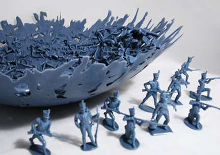 Bowl made of melted plastic toy soldiers.