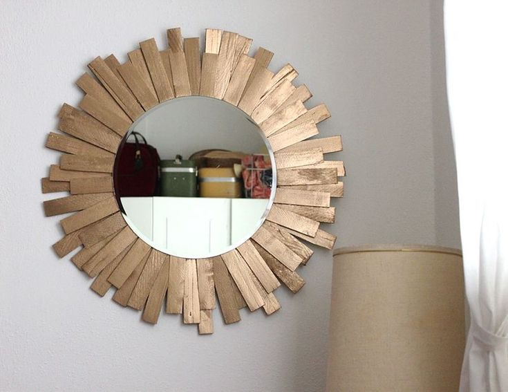 Yep, this chic wooden mirror is totally DIY-able.