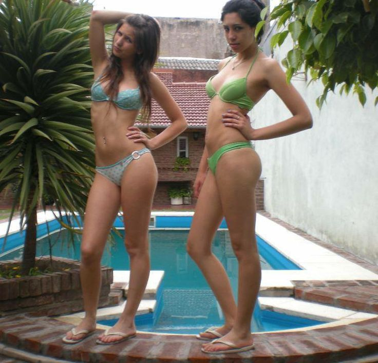 Two Cute Young Tall Girls In Bikinis On A Swimming Pool