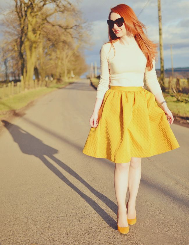 yellow 50s style skirt and high heels