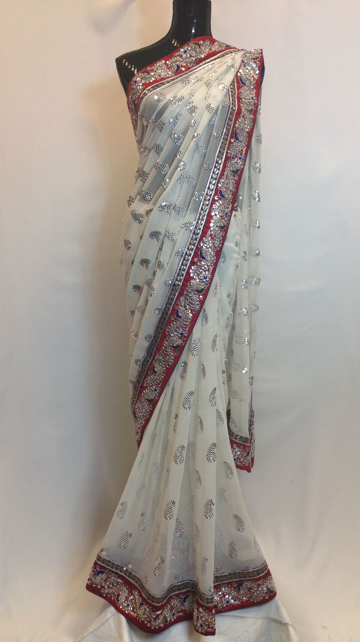Stylish and gorgeous white and red saree with silver embroidery sequins work on border and pallu along with allover motifs makes this indian apparel to die for. High in demand due to its like texture.