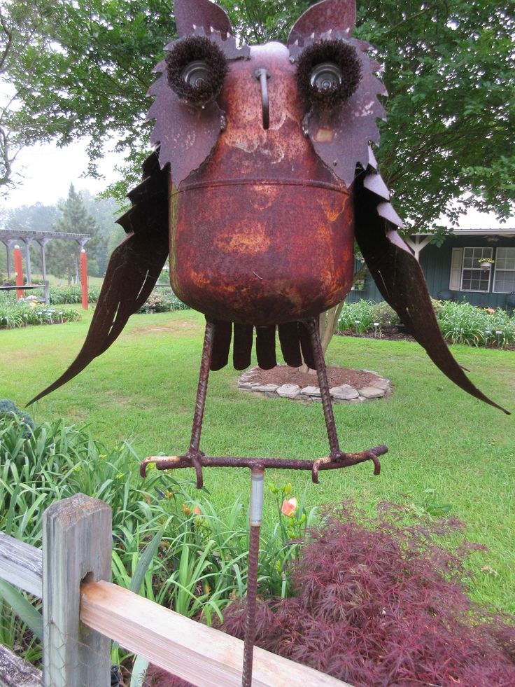 GARDEN ART. The owl is right at the front entrance to the display garden. Everyone loves this smart old owl. The body is made from a rusty propane tank. #gardenart