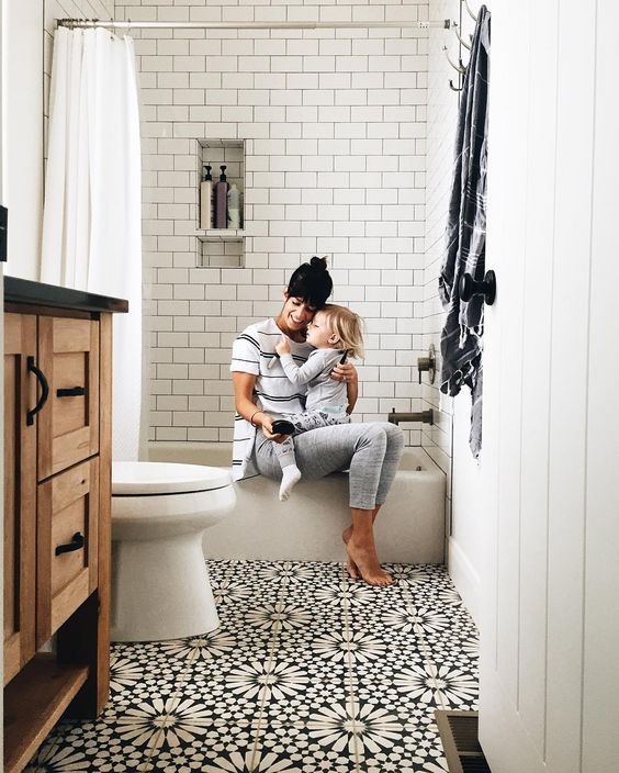This patterned floor tile is busy (good busy). Keeping the other materials and surfaces neutral allows the floor to shine without overwhelming the bathroom.