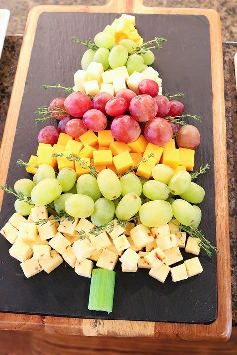 Next I made a fun Fruit & Cheese Christmas Tree! Arrange cubes of pepper jack, cheddar, mozzarella, and colby jack cheese with red and green grapes to form a tree. Then tuck fresh thyme sprigs between the layers. A slice of celery is the finishing touch for a perfect tree trunk.